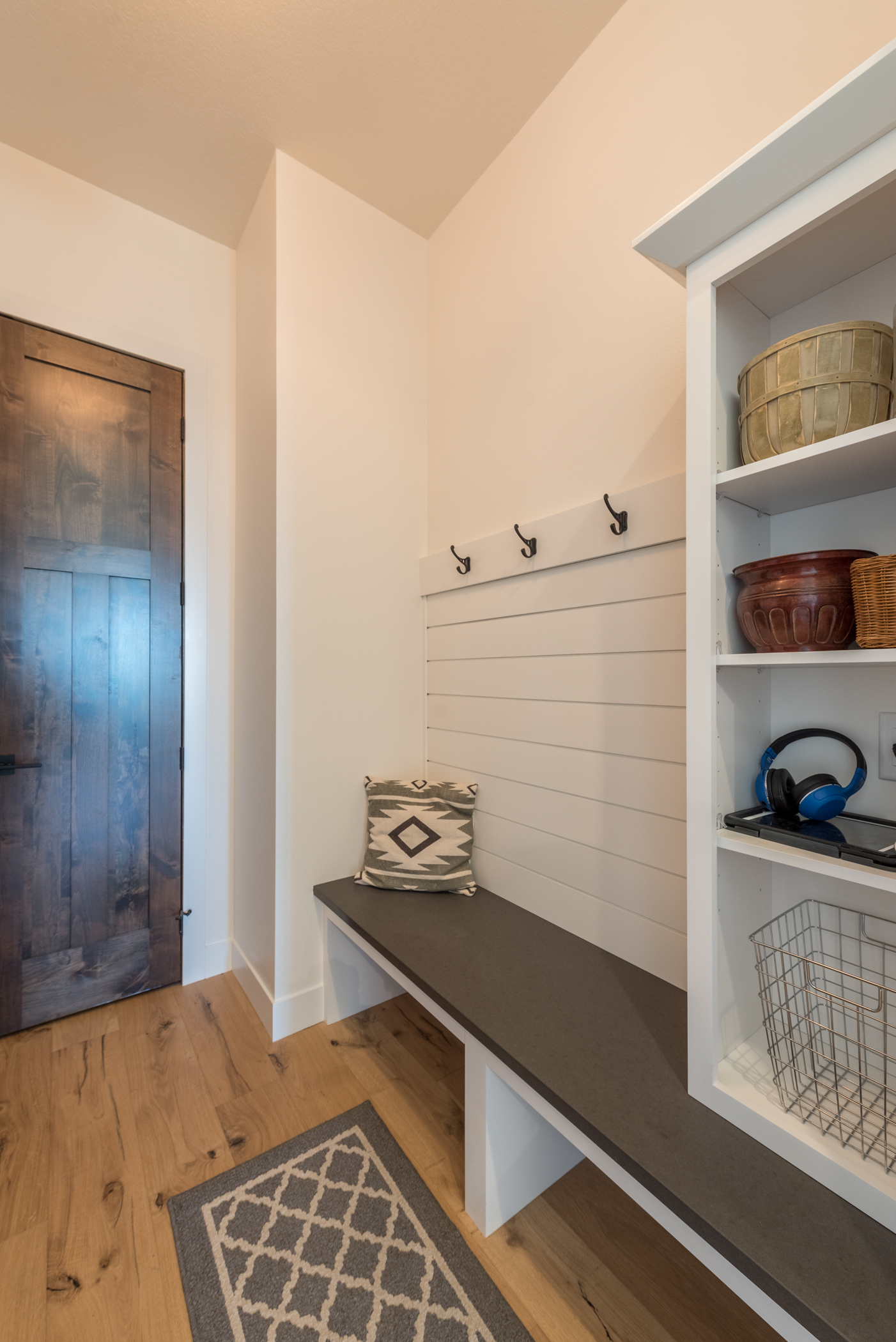 Entryway mudroom with shiplap paneling, bench and cubbies