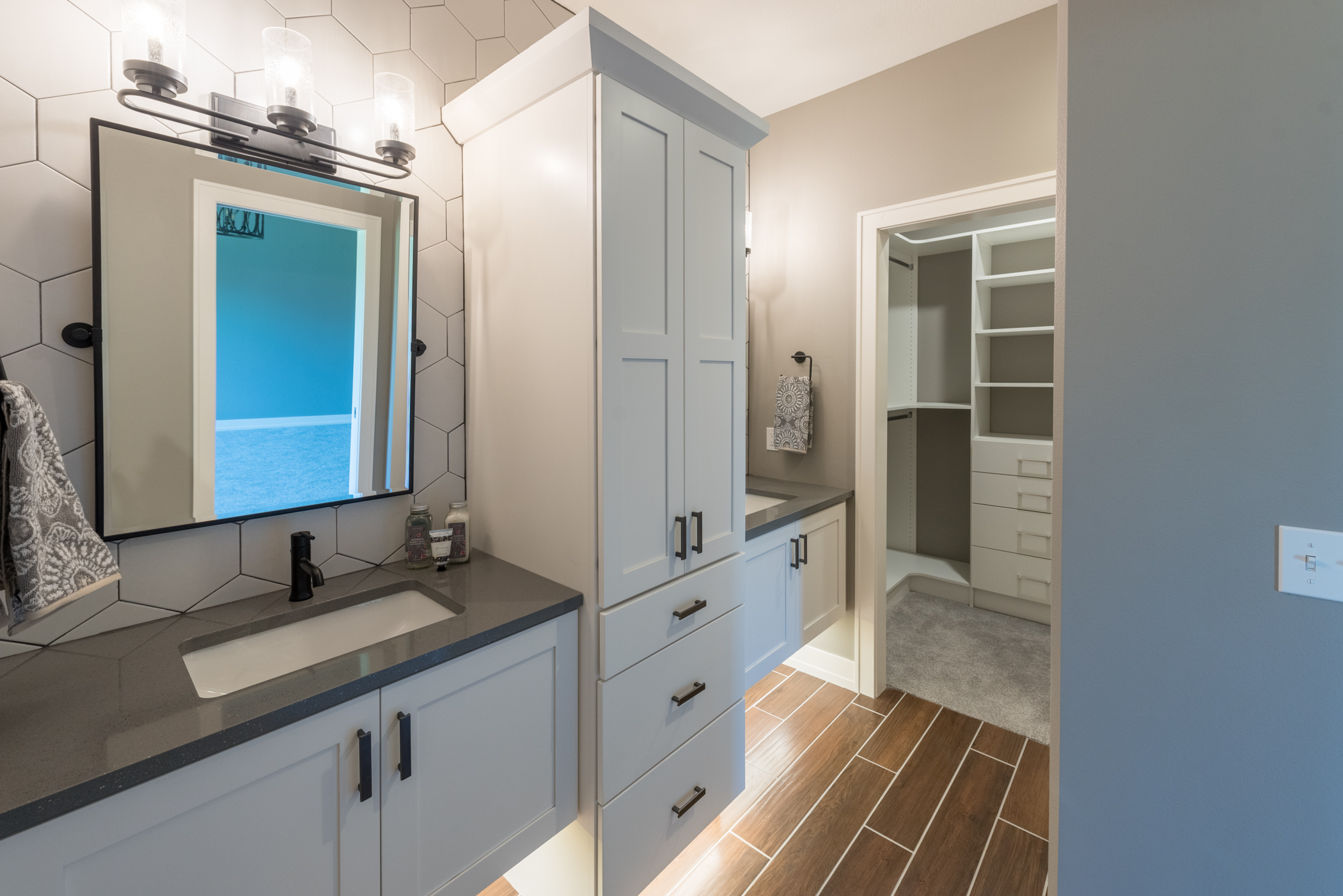 Contemporary bathroom with white cabinetry and undermount lighting
